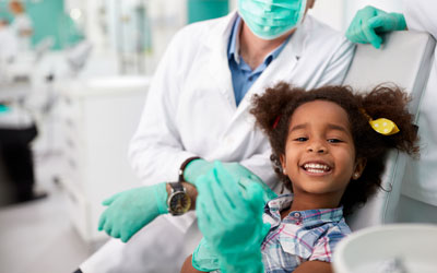 Smiling young girl at dentist