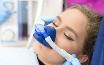 Woman receiving gas anesthesia at dentist